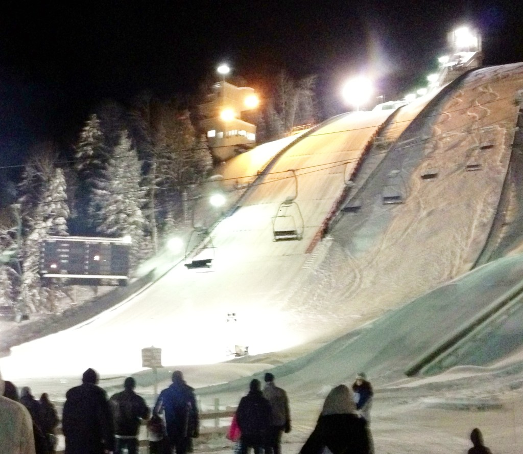 {Ski jumps lit up for the competition.}