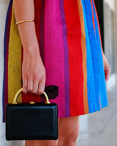 {Bright skirt, simple bag.}