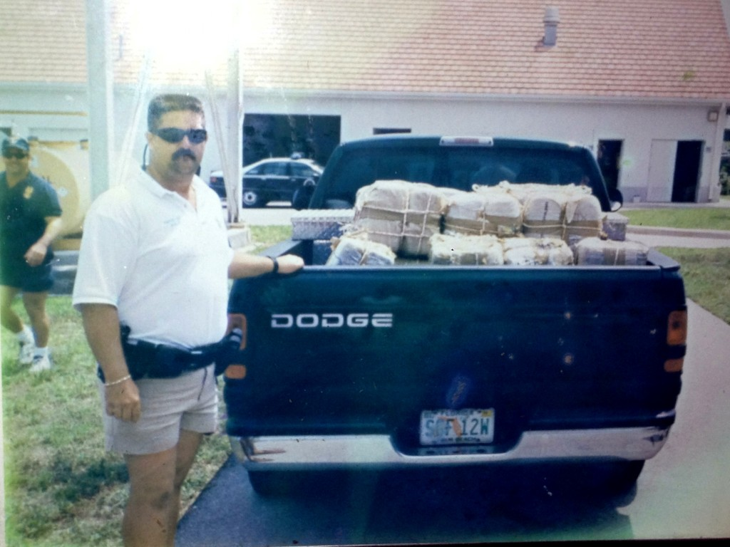 "{D.E.A. officer with a truck bed full of ""square groupers."" Photo hangs in the bar area of the Square Grouper.}"